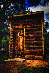 A picture of an outhouse.